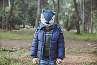 Boy wearing funny wooly hat in forest - RTBF00625