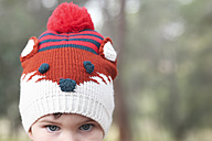 Close-up of boy wearing funny wooly hat - RTBF00631