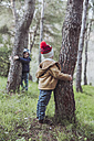 Two boys playing in forest - RTBF00640