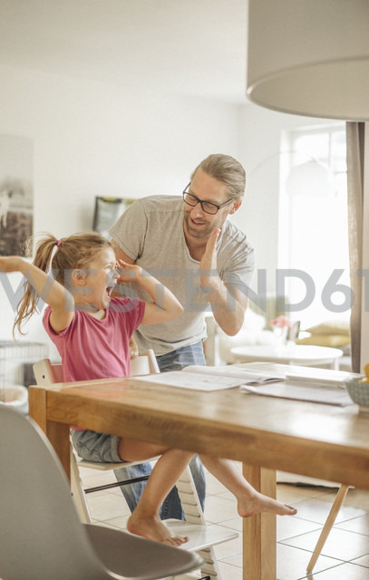 Father high fiving with daughter - JOSF00477