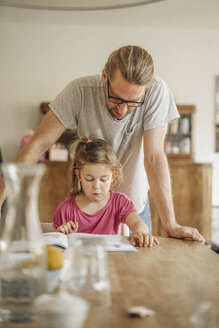 Father checking homework of his daughter - JOSF00480