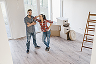 Couple standing in their new home - JOSF00542