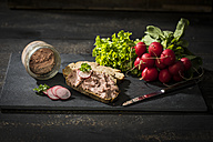 Liverwurst spread on slice of brown bread - MAEF12130