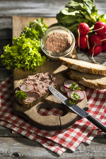 Liverwurst spread on slice of brown bread - MAEF12133