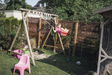 Girl on swing in garden - JOSF00590