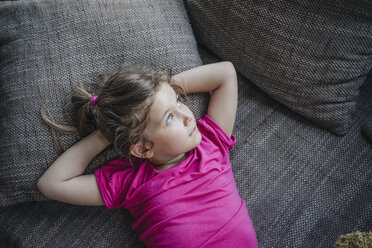 Portrait of girl lying on couch - JOSF00593