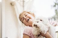 Happy girl playing with dog - JOSF00605