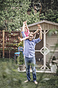 Father carrying daughter in garden - JOSF00608