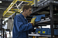 Factory worker in truck manufacture assembling truck parts - ZEF12764