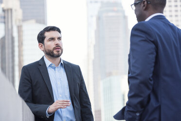 Two businessmen talking outdoors - WESTF22636