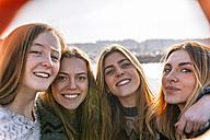 Portrait of four happy friends taking selfie - MGOF02965