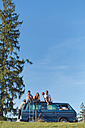 Group of friends sitting on van in the nature - WVF00839