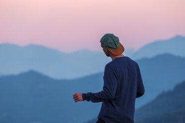 Austria, Mondsee, Mondseeberg, rear view of man wearing a basecap at dusk - WVF00848