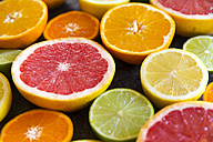 Sliced citrus fruits, close-up - SARF03178