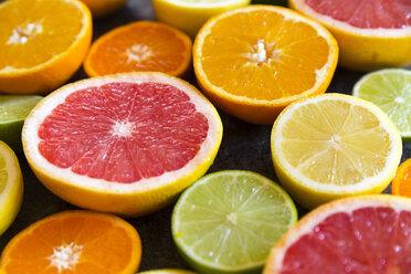 Sliced citrus fruits, close-up - SARF03178