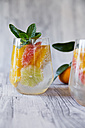 Two glasses of detox water infused with citrus fruits - SARF03181