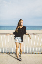 Portrait of smiling young woman at the beach - GIOF01826