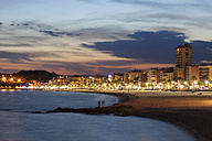 Spain, Catalonia, Lloret de Mar, resort town on Costa Brava, beach and skyline at twilight - ABOF00159