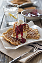Plate of waffles with whipped cream, cherries and cherry groats - YFF00639