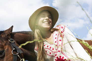 Happy girl with horse - FSF00785