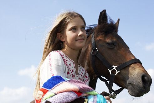 Smiling girl with horse - FSF00788