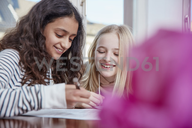 Two girls doing homework together - RHF01800