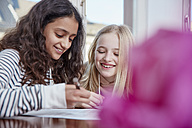 Two girls doing homework together - RHF01800