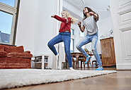 Two girls dancing at home - RHF01806