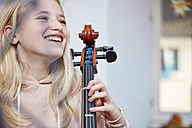 Portrait of happy girl with cello - RHF01815