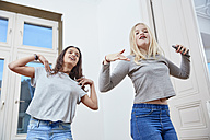 Two girls dancing at home - RHF01830