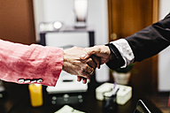 Close-up of two businesswomen shaking hands in office - JRFF01188