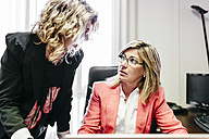 Two businesswomen working together in office - JRFF01194