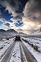 UK, Scotland, Glen Etive, Four wheel drive vehicle in winter - SMAF00671
