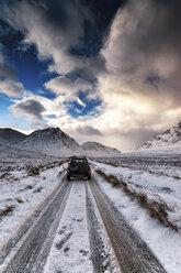 UK, Scotland, Glen Etive, Four wheel drive vehicle in winter - SMAF00671