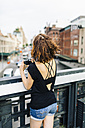 USA, New York City, back view of woman with camera on the High Line in Manhattan - GIOF01873