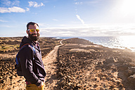 Spain, Tenerife, portrait of happy hiker at sunlight - SIPF01413