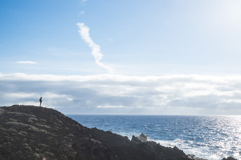 Spain, Tenerife, silhouette of man looking at the sea - SIPF01419