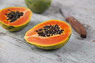 Sliced papaya on wood - JUNF00839