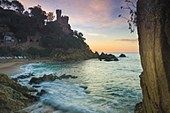 Spain, Costa Brava, Lloret de Mar, view from the beach to Castillo de los Plaja at sunrise - SKCF00255