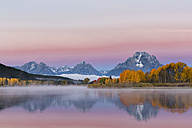 USA, Wyoming, Rocky Mountains, Teton Range, Grand Teton National Park, Snake River, Oxbow Bend, Mount Moran, Indian Summer, twilight - FOF08865