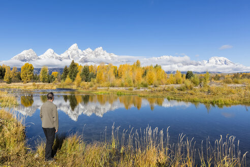 USA, Wyoming, Rocky Mountains, Grand Teton National Park, Cathedral Group, tourist at Snake River - FOF08873
