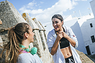 Two friends talking in the street after workout - KIJF01239