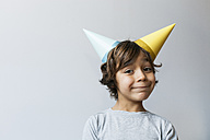 Portrait of little boy with two party hats on his head - VABF01155