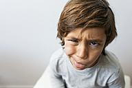 Portrait of little boy pulling funny faces - VABF01158