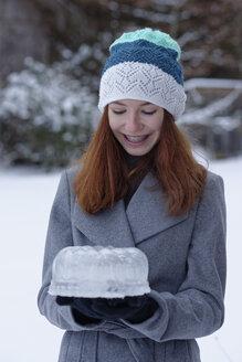 Happy teenage girl with cake made of ice - LBF01564