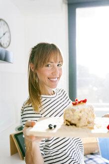 Young woman presenting vegan cake - VABF01193