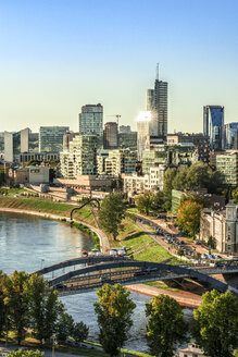 Lithuania, Vilnius, view to the modern city of Vilnius with Europa Tower and Neris River in the foreground - CSTF01223