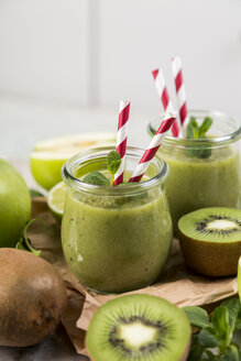 Glasses of green smoothie and ingredients - JUNF00863