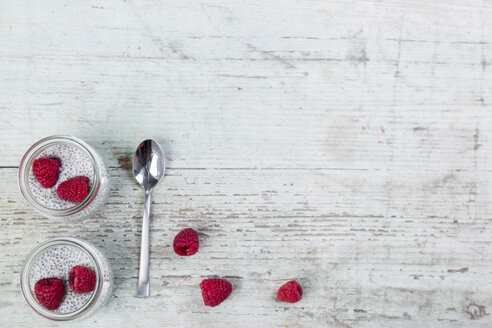 Glass of chia pudding with soya vanilla milk and raspberries - JUNF00875