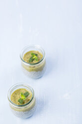 Two glasses of chia pudding with soya vanilla milk and kiwi mush - JUNF00878